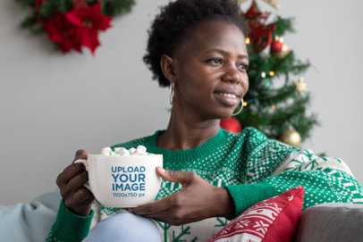 Mockup of a Woman Having a Hot Cocoa With Marshmallows in a 24 oz Mug 30348