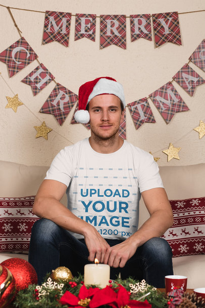 T-Shirt Mockup of a Man Wearing a Christmas Hat at Home 30172