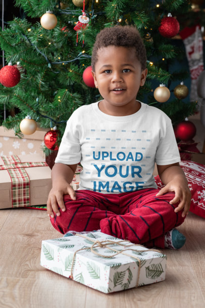 T-Shirt Mockup of a Young Boy Ready to Open His Christmas Present 30364