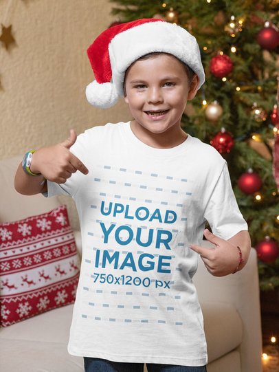 Christmas Mockup of a Kid with a Santa Claus Hat Pointing at His T-Shirt 30205