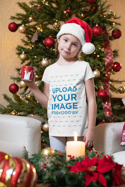 Christmas T-Shirt Mockup Featuring a Little Girl Having Hot Cocoa 30201