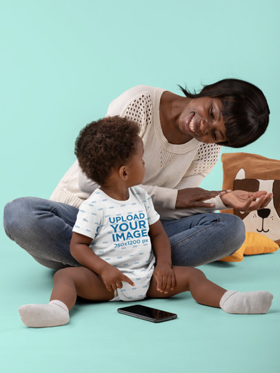 Mockup of a Baby Wearing a Onesie While Playing with His Mom 30020