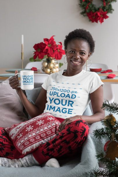 T-Shirt Mockup of a Woman Holding a 15 oz Coffee Mug at a Christmas Decorated Living Room 30362