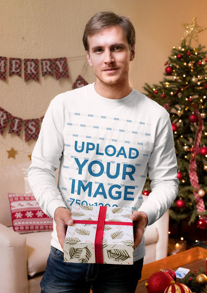 Long Sleeve Tee Mockup of a Man Holding a Christmas Gift 30174