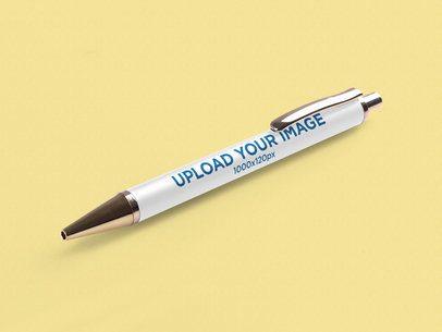 Pen Mockup Featuring a Solid Color Backdrop 1002-el