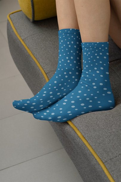 Mockup of a Woman Standing on the Edge of a Couch Wearing Sublimated Socks 29530