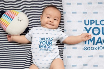 Onesie Mockup of a Baby Boy Lying on a Blanket 30016