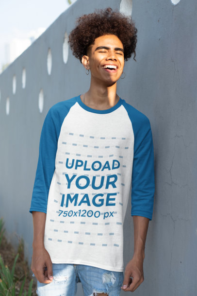 Mockup of a Young Man Wearing a Raglan Tee with Three-Quarter Sleeves 30219