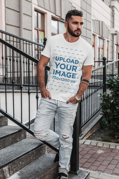 T-Shirt Mockup of a Serious-Looking Man Standing on Concrete Steps 1023-el