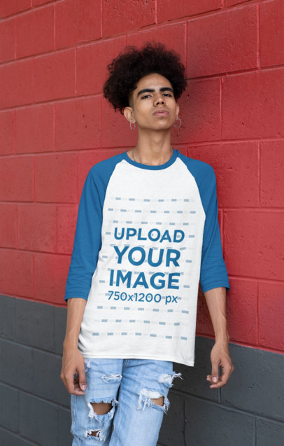 Mockup of a Man Wearing a Raglan Shirt with Three-Quarter Sleeves Leaning on a Wall 30227