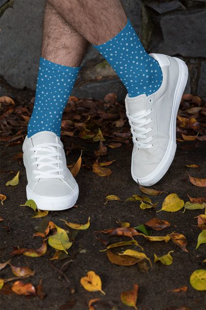 Socks Mockup Featuring a Man with Crossed Legs by Some Fall Leaves 29554