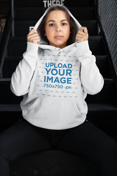 Mockup of a Woman Wearing a Plus Size Hoodie Sitting on a Staircase 30153