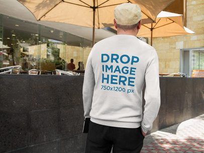 Back of a Hispanic Middle-Aged Man Wearing a Crewneck Sweatshirt Mockup Outside a Restaurant a10854b