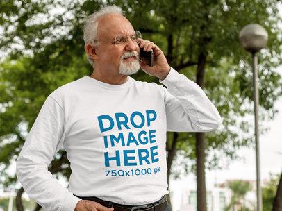Long Sleeve Tee Mockup of a Senior Man Talking on His Phone a10942
