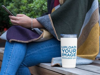 20 oz Travel Mug Mockup Featuring a Woman Looking at Her Phone 30399