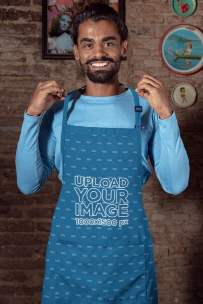 Mockup Featuring a Man with a Hair Bun Wearing an Apron 30299