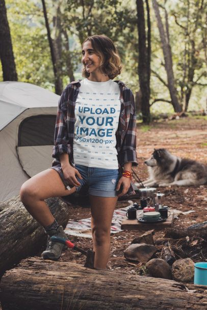 Mockup of a Young Woman at a Campfire Wearing a Customizable T-Shirt 30469