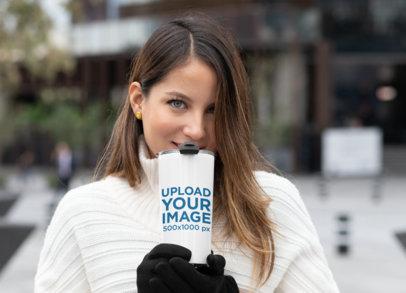 20 oz Travel Mug Mockup Featuring a Woman in a Winter Scenario 30427a