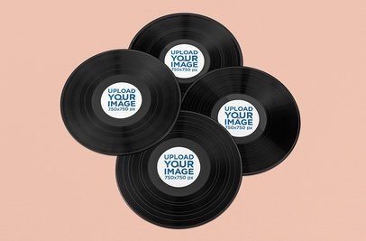 Mockup Featuring Four Vinyl Records Lying on a Solid Color Surface 1040-el