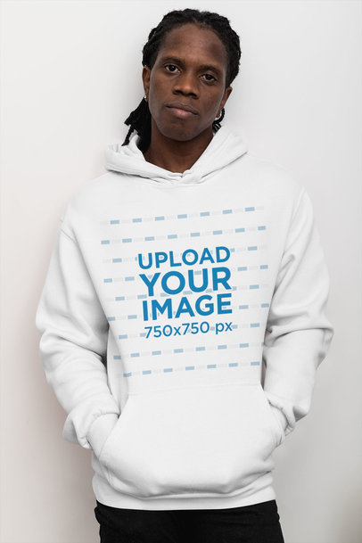 Pullover Hoodie Mockup Featuring a Serious-Looking Man by a Clear Wall 30322