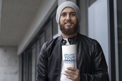 Mockup of a Man Holding a Travel Mug in Winter 30380