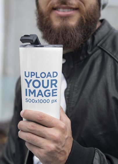 Mockup of a Bearded Man Wearing a 20 oz Travel Mug in Winter 30383