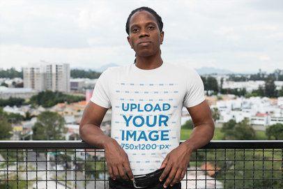 T-Shirt Mockup Featuring a Man at a Balcony 30318