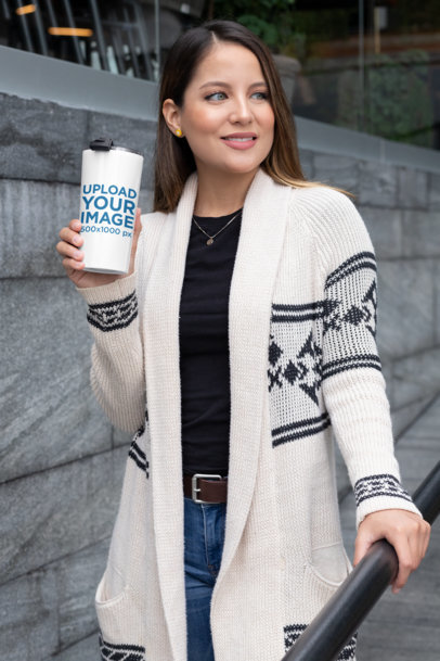 Mockup of a Woman Walking in the City with a Travel Mug 30425