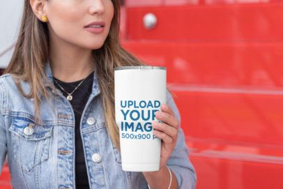 Mockup of a Cropped Face Woman Holding a 30 oz Travel Mug 30419