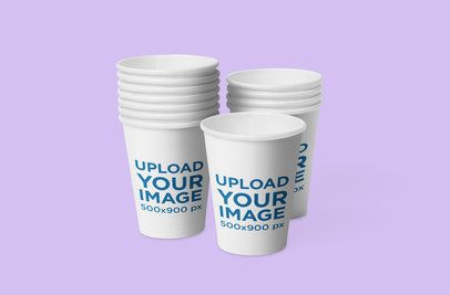Mockup Featuring Several Coffee Cups Placed Against a Solid Color Backdrop 1072-el