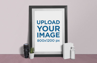 Photo Frame Mockup Featuring a Camera Lens and a Plant Pot