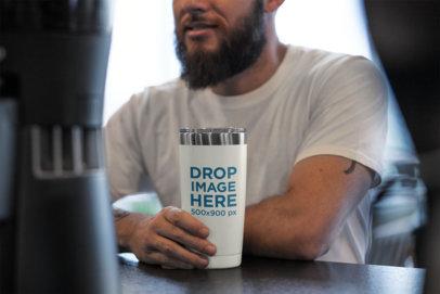 20 oz Travel Mug Mockup of a Man Sitting at a Cafe 30392