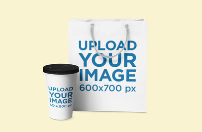 Mockup Featuring a Coffee Cup and a Gift Bag Placed Against a Solid Color Background 1073-el