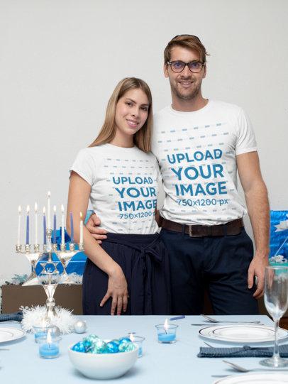 Mockup of a Couple Wearing T-Shirts at a Hanukkah Celebration 30633