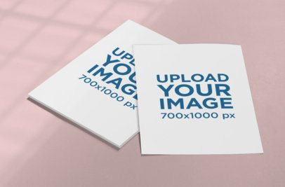 Mockup Featuring Two Letterheads Placed on a Solid Color Surface 1027-el