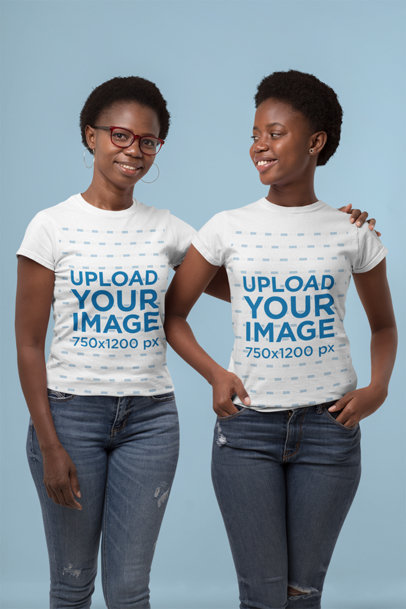 Mockup of a Mother and Her Daughter Wearing T-Shirts at a Studio