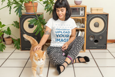 T-Shirt Mockup Featuring a Woman and Her Cat at Home