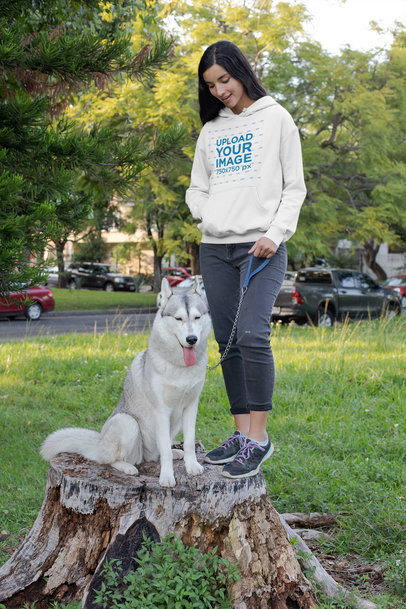 Pullover Hoodie Mockup Featuring a Woman with Her Dog at the Park 30661