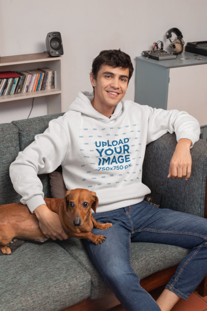 Pullover Hoodie Mockup Featuring a Young Man Sitting on a Couch with His Dog 30681