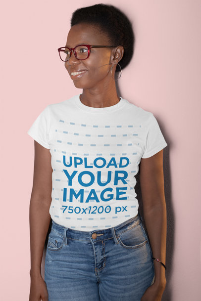 T-Shirt Mockup Featuring a Smiling Woman with Short Hair at a Studio