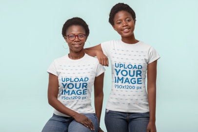 Mockup of Mother and Daughter Wearing Matching T-Shirts in a Studio 30618