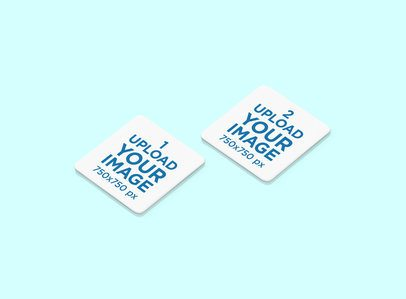 Mockup Featuring Two Square Coasters Placed on a Solid Color Surface 1222-el