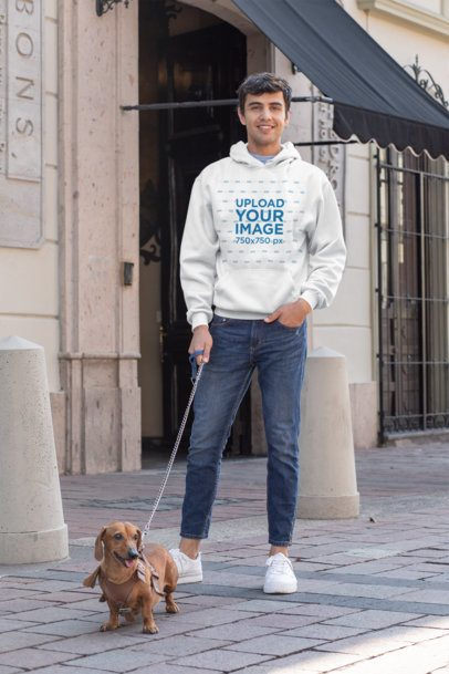 Mockup of a Man Wearing a Pullover Hoodie While Walking His Dog 30686