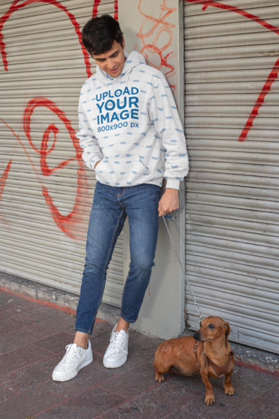 Pullover Hoodie Mockup of a Man Leaning on a Graffiti Wall with His Dog 30687