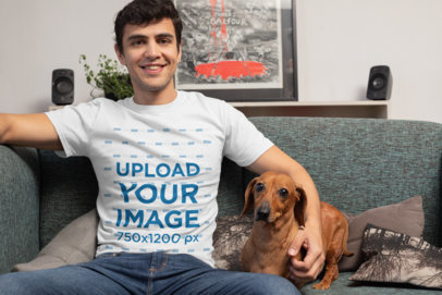 T-Shirt Mockup of a Man in the Living Room with His Dog 30680