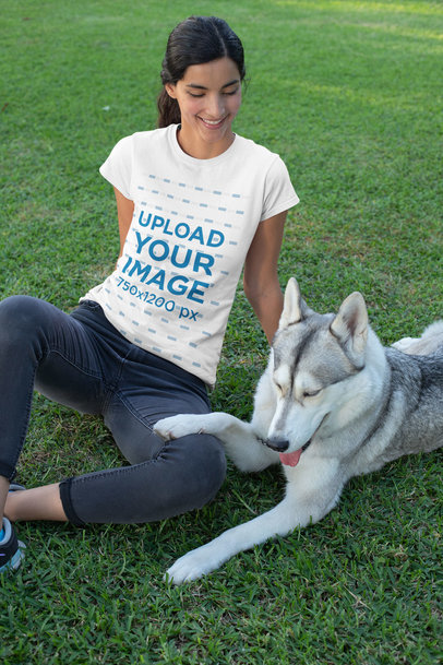 T-Shirt Mockup of a Woman Sitting on the Grass with Her Dog 30659