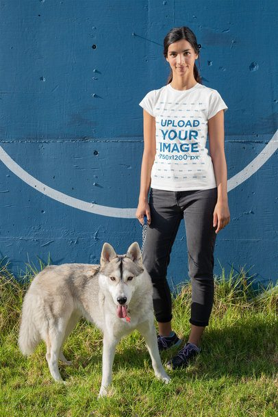 T-Shirt Mockup of a Young Woman Standing Next to Her Dog 30652