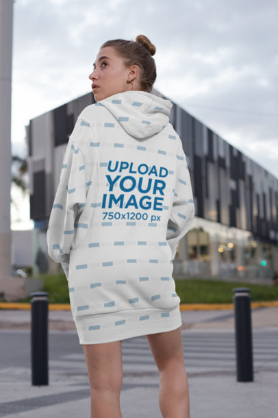 Back View Mockup of a Woman Wearing a Sublimated Hoodie Dress in the City 30577