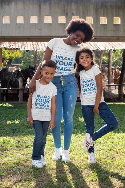T-Shirt Mockup Featuring a Mother with Her Kids by a Barn 30599