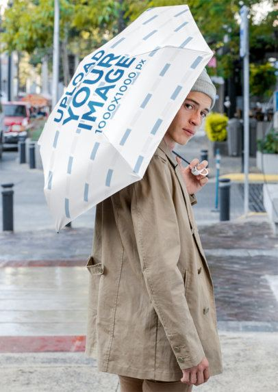Mockup of a Man Holding an Umbrella on the Street 30720